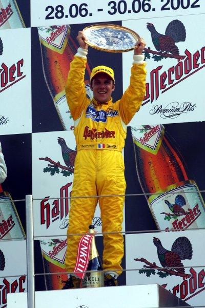 2002 DTM Championship Norisring, Germany. 29th - 30th June 2002. Race winner Laurent Aiello (Abt Audi TT-R), podium.World Copyright: Andre Irlmeier/LAT Photographic