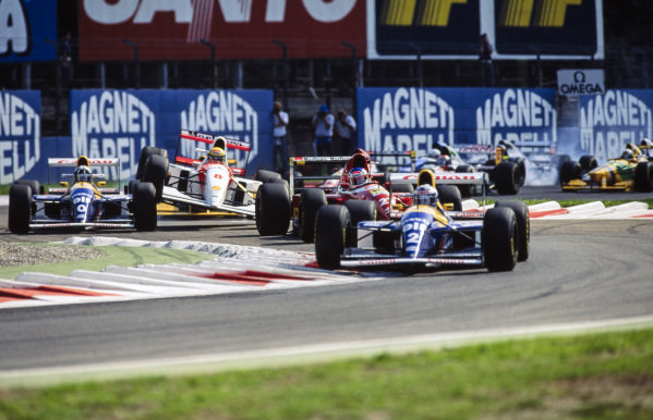 Ayrton Senna, McLaren MP4-8 Ford, flies into the air after contact with Damon Hill, Williams FW15C Renault. Up front, Alain Prost, Williams FW15C Renault, leads Jean Alesi, Ferrari F93A.
