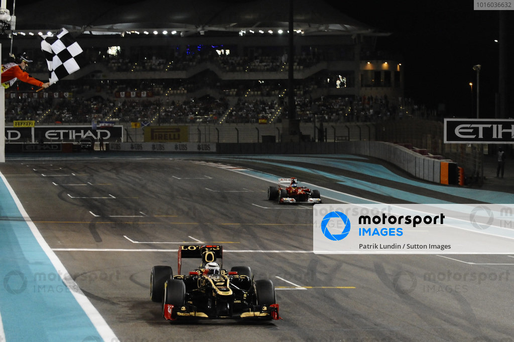 Race winner Kimi Raikkonen (FIN) Lotus E20 takes the chequered flag. Formula One World Championship, Rd18, Abu Dhabi Grand Prix, Race, Yas Marina Circuit, Abu Dhabi, UAE, Sunday 4 November 2012.