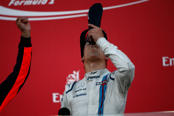 Baku City Circuit, Baku, Azerbaijan. Sunday 25 June 2017. Lance Stroll, Williams Martini Racing, 3rd Position, drinks from the shoe of winner Daniel Ricciardo, Red Bull Racing, 1st Position, on the podium. World Copyright: Andrew Hone/LAT Images ref: Digital Image _ONY9192