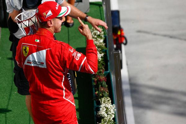 Hungaroring, Budapest, Hungary.  Sunday 30 July 2017. Sebastian Vettel, Ferrari, 1st Position, celebrates on the podium. World Copyright: Andrew Hone/LAT Images  ref: Digital Image _ONZ1210