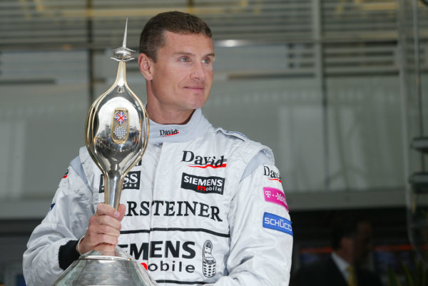 2003 British Grand Prix - Firday Qualifying,Silverstone, Britain. 18th July 2003 David Coulthard, West McLaren Mercedes MP4/17D receives the Hawthorn memorial trophy.World Copyright LAT Photographic.Digital Image Only.