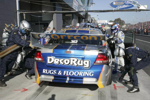 2004 Australian V8 Supercars. Bathurst 1000, Bathurst, Australia. 10th October 2004Jason Bargwanna (Ford) gets into the car to do a stint of the race. Action. Photo: Mark Horsburgh/LAT Photographic Ref:Digital Image only