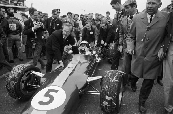 Jim Clark celebrating the first victory for the Lotus 49 Ford with Lotus team owner Colin Chapman and Keith Duckworth (at the back of the car).