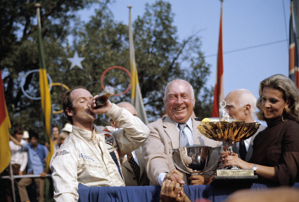 Peter Gethin celebrates victory on the podium. Next to him his BRM team boss Louis Stanley and Lorenzo Bandini's wife Margherita Freddi.