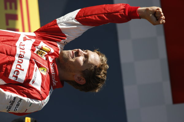 Hungaroring, Budapest, Hungary. Sunday 26 July 2015. Sebastian Vettel, Ferrari, 1st Position, celebrates victory on the podium. World Copyright: Charles Coates/LAT Photographic ref: Digital Image _J5R8431