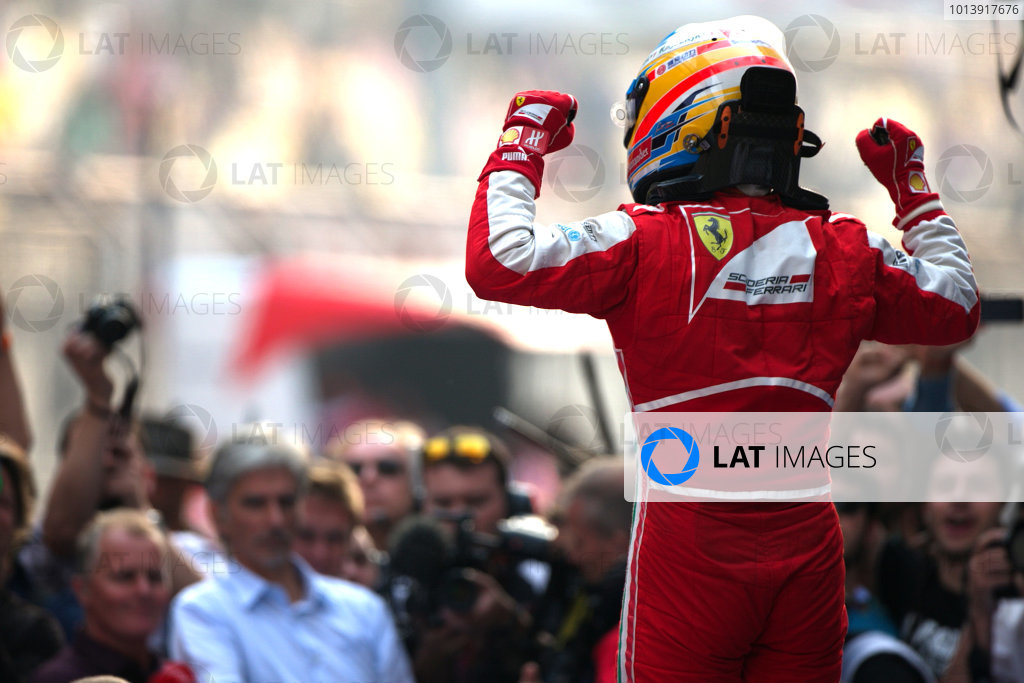 Shanghai International Circuit, Shanghai, China Sunday 14th April 2013 Fernando Alonso, Ferrari, 1st position, celebrates upon arrival in Parc Ferme. World Copyright: Andy Hone/LAT Photographic ref: Digital Image HONZ7709