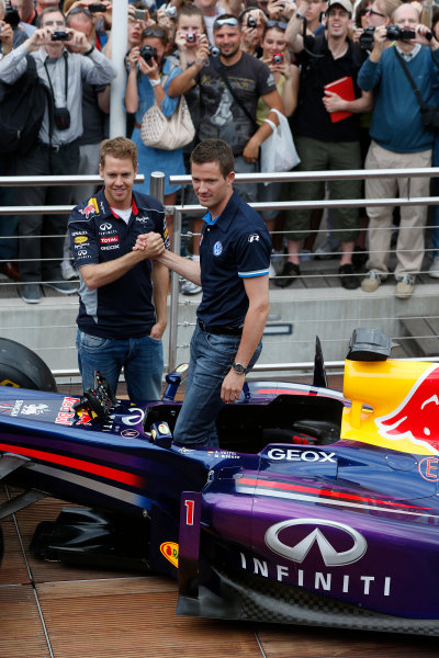 Monte Carlo, Monaco 22nd May 2013 Sebastian Vettel, Red Bull Racing meets Sebastian Ogier World Copyright: Charles Coates/LAT Photographic ref: Digital Image _N7T0608
