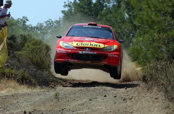 Gilles Panizzi (FRA) / Herve Panizzi (FRA) Peugeot 206 WRC.World Rally Championship, Rd7, Cyprus Rally, Shakedown, 19 June 2003.DIGITAL IMAGE