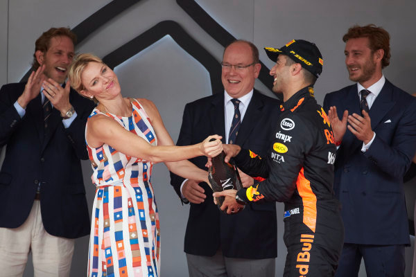 Princess Charlene and Prince Albert of Monaco with Daniel Ricciardo, Red Bull Racing, 1st position, on the podium.