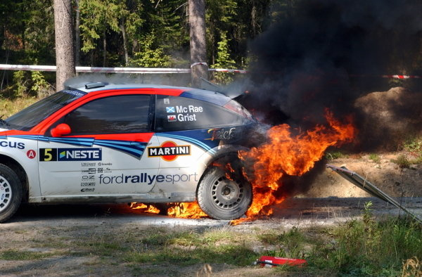 Colin McRae (GBR) had to evacuate his Ford Focus RS WRC after a loose hydraulic line caught fire at the end of stage 20.FIA World Rally Championship, Rd9, Neste Rally Finland, Day Three, Finland. 11 August 2002.DIGITAL IMAGE