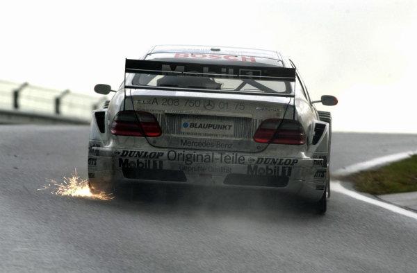 Peter Dumbreck, (GBR) Original-Teile AMG-Mercedes CLK sparks his way to 13th place.DTM Championship, Rd9, Zandvoort, Holland. 29 September 2002.DIGITAL IMAGE