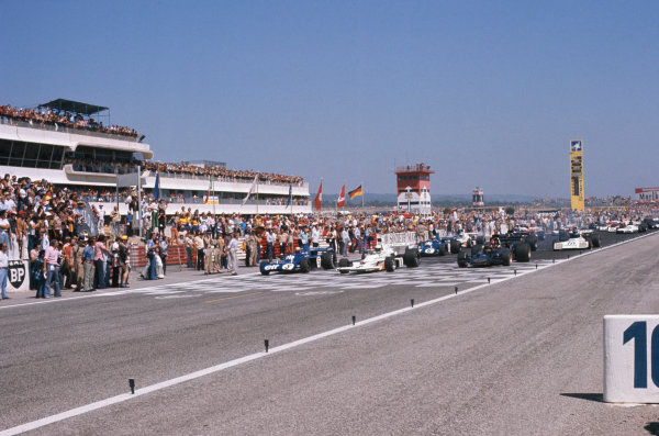1973 French Grand Prix.  Paul Ricard, Le Castellet, France. 29th June - 1st July 1973.  Jackie Stewart, Tyrrell 006 Ford, Jody Scheckter, McLaren M23 Ford, and Emerson Fittipaldi, Lotus 72E Ford, lead off the front row of the grid at the start.  Ref: 73FRA16. World Copyright: LAT Photographic