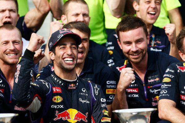 Hungaroring, Budapest, Hungary. Sunday 27 July 2014. Daniel Ricciardo, Red Bull Racing, 1st Position, celebrates with his team. World Copyright: Sam Bloxham/LAT Photographic. ref: Digital Image _SBL1326