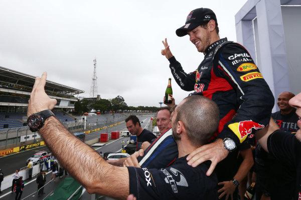 Interlagos, Sao Paulo, Brazil. Sunday 25th November 2012. Sebastian Vettel, Red Bull Racing, 2012 F1 World Champion, celebrates with his team. World Copyright:Andy Hone/LAT Photographic ref: Digital Image HONZ3884