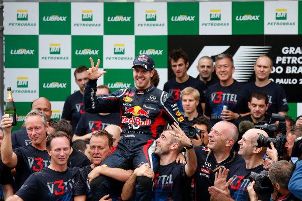 Interlagos, Sao Paulo, Brazil. Sunday 25th November 2012. Sebastien Vettel, Red Bull Racing celebrates with his team after winning the 2012 wolrd championship. World Copyright:Charles Coates/LAT Photographic ref: Digital Image _N7T8281