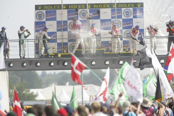 2006 Le Mans 24 Hours, Le Mans, France.14th - 18th June. LMP1 Podium. F Biela (DEU)/ E Pirro (ITA)/ M Werner (DEU), Audi Sport Team Joest. and  E Helary (FRA)/ S Loeb (FRA)/ F Montagny (FRA), Pescarolo Sport, Pescarolo Judd. and R Capello (ITA)/ T Kristensen (DNK)/ A McNish (GBR), Audi Sport Team Joest. Celebrate on the podium.World Copyright: Andrew Ferraro/LAT PhotographicRef: Digital Image Only ZP9O1532