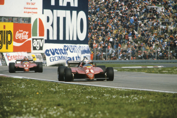 Imola, Italy. 23rd - 25th April 1982.Didier Pironi (Ferrari 126C2), 1st position, leads teammate, Gilles Villeneuve (Ferrari 126C2), 2nd position, action. World Copyright: LAT Photographic.Ref:  82SM15
