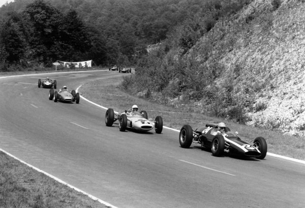 1962 French Grand Prix Rouen-les-Essarts, France. 6-8 July 1962 Tony Maggs (Cooper T60-Climax) leads Masten Gregory (Lotus 24-BRM), Jo Bonnier (Porsche 804), Jackie Lewis (Cooper T53-Climax), Jo Siffert (Lotus 24-BRM) and Trevor Taylor (Lotus 25-Climax). Maggs finished in 2nd position World Copyright: LAT PhotographicRef: Autosport b&w print