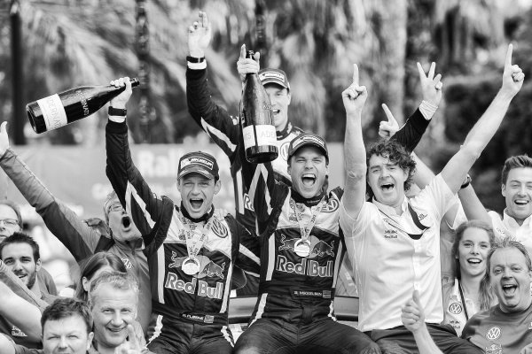 Race winners Andreas Mikkelsen (NOR) / Ola Floene (NOR) Volkswagen WRC celebrate with the team on the podium at FIA World Rally Championship, Rd12, RAAC Rally de Espana, Day Three, Costa Daurada, Catalunya, Spain, 25 October 2015.