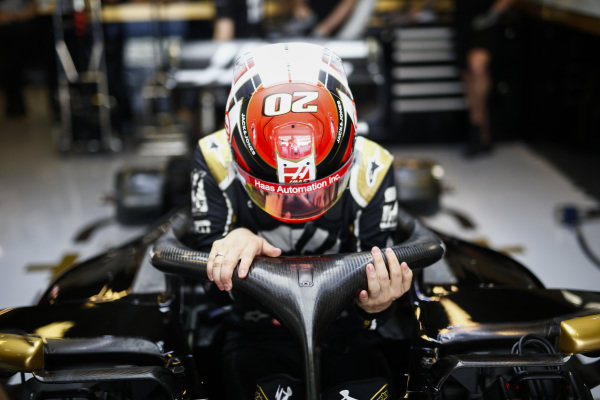 Kevin Magnussen, Haas F1, enters his cockpit
