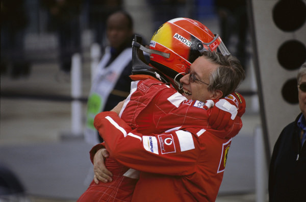 Michael Schumacher celebrates with Paolo Martinelli.