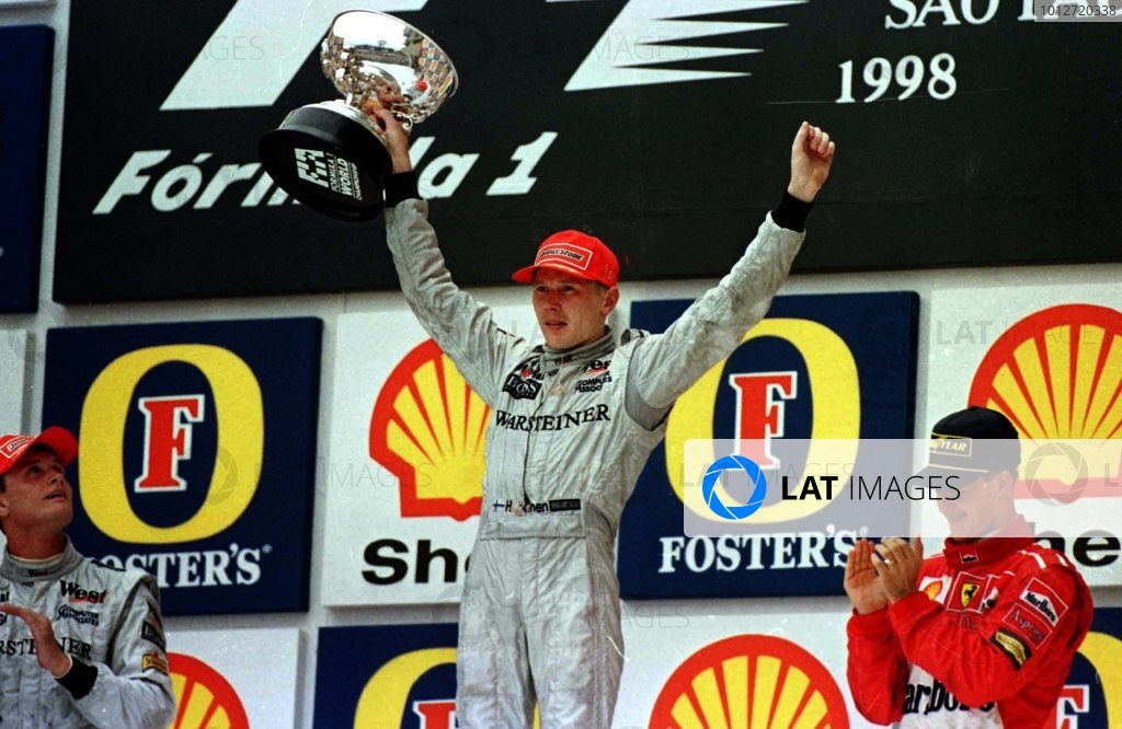 1998 Brazilian Grand Prix.Interlagos, Sao Paulo, Brazil.27-29 March 1998.Mika Hakkinen, David Coulthard (McLaren Mercedes-Benz) and Michael Schumacher (Ferrari) after finishing in 1st, 2nd and 3rd positions respectively.World Copyright - LAT Photographic