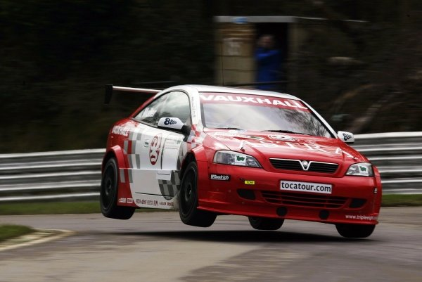 Yvan Muller (FRA) manages to get his Vauxhall Motorsport Astra Coupe airborne at Dingle Dell.British Touring Car Testing, Brands Hatch, England.19 March 2002.