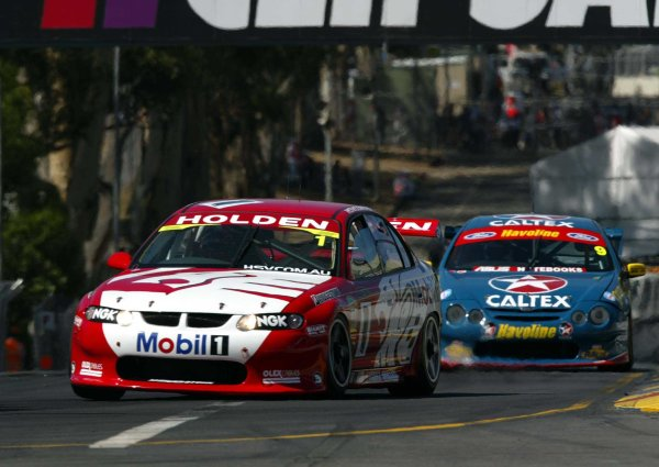 2002 Australian V8 SupercarsAdelaide Clipsal 500. Australia. 17th March 2002.Holden Racing Team's Mark Skaife and Caltex Havoline driver David Besnard on the streets of Adelaide during the opening laps of the race one.World Copyright: Mark Horsburgh/LAT Photographicref: Digital Image Only
