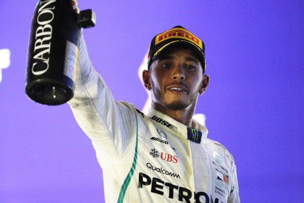 Lewis Hamilton, Mercedes AMG F1, celebrates on the podium after winning the race