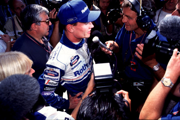 1995 Italian Grand Prix. Monza, Italy. 8-10 September 1995. David Coulthard (Williams Renault) is interviewed by Tony Jardine after qualifying on pole position. World Copyright - LAT Photographic