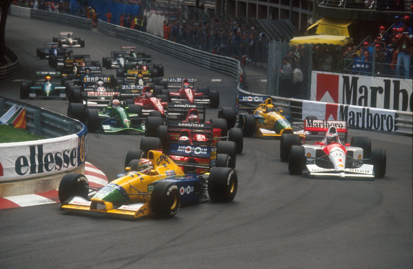 1991 Monaco Grand Prix.Monte Carlo, Monaco.26-28 April 1991.Nelson Piquet (Benetton B191 Ford) followed by Alain Prost (Ferrari 642), Gerhard Berger (McLaren MP4/6 Honda), Jean Alesi (Ferrari 642), Roberto Moreno (Benetton B191 Ford) and Andrea de Cesaris (Jordan 191 Ford) into Ste. Devote at the start. Note Berger's damaged front wing, caused by running into the back of Piquet.Ref-91 MON 19.World Copyright - LAT Photographic