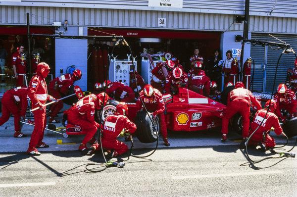 Eddie Irvine, Ferrari F399, makes a pit stop.