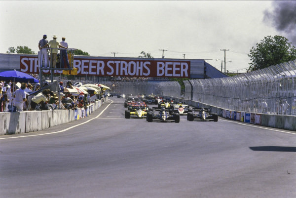 Nigel Mansell, Lotus 95T Renault, leads Elio de Angelis, Lotus 95T Renault, Derek Warwick, Renault RE50, Ayrton Senna, Toleman TG184 Hart, Niki Lauda, McLaren MP4-2 TAG, Alain Prost, McLaren MP4-2 TAG, and Patrick Tambay, Renault RE50, at the start.