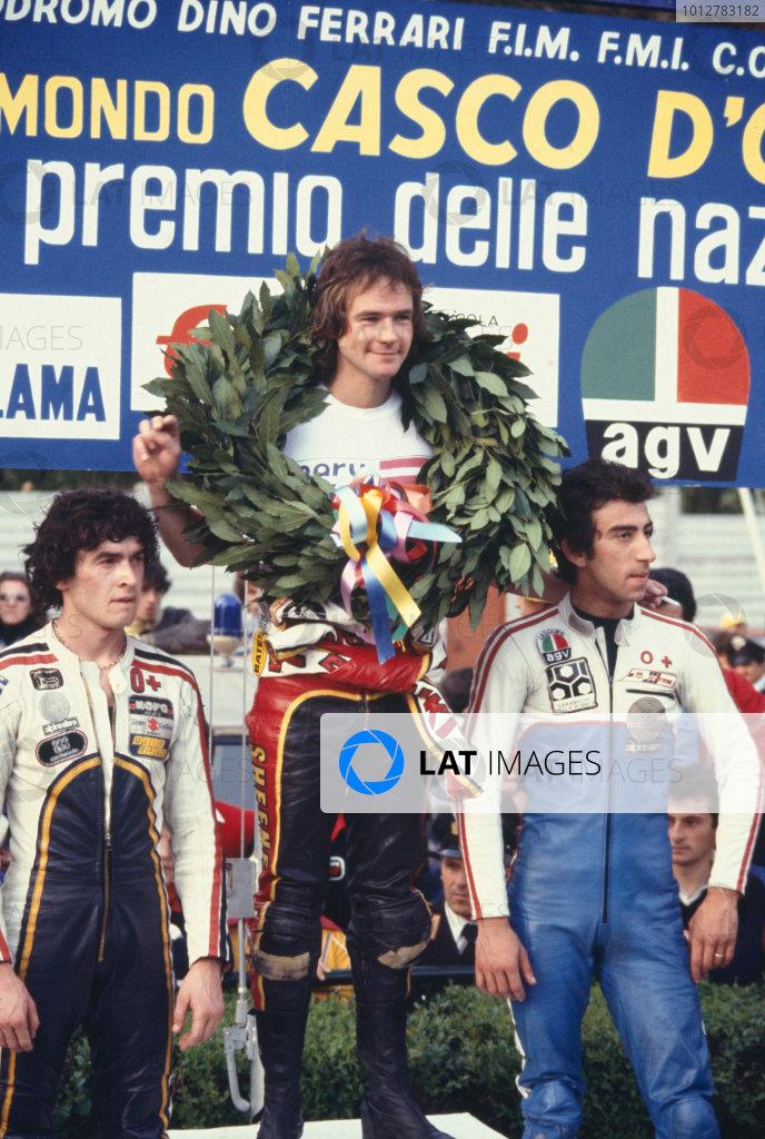 500cc Nations Grand Prix.Imola, Italy.14-15 May 1977.Virginio Ferrari (Suzuki) 2nd position, Barry Sheene (Suzuki) 1st position and Armando Toracca (Suzuki) 3rd position, celebrate on the podium.(Non-Championship Race).Ref-SHEENE 02World Copyright - LAT Photographic