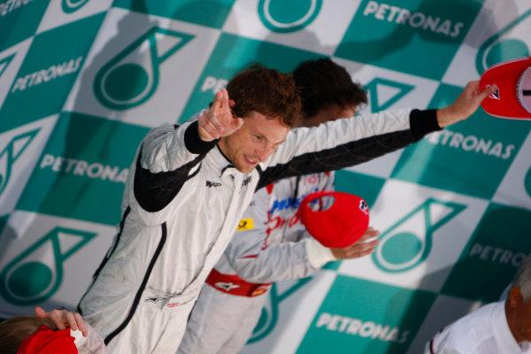Sepang, Kuala Lumpur, Malaysia5th April 2009Jenson Button, Brawn GP BGP001 Mercedes, 1st position, celebrates on the podium. Portrait. Podium. World Copyright: Steven Tee/LAT Photographicref: Digital Image _95U0126