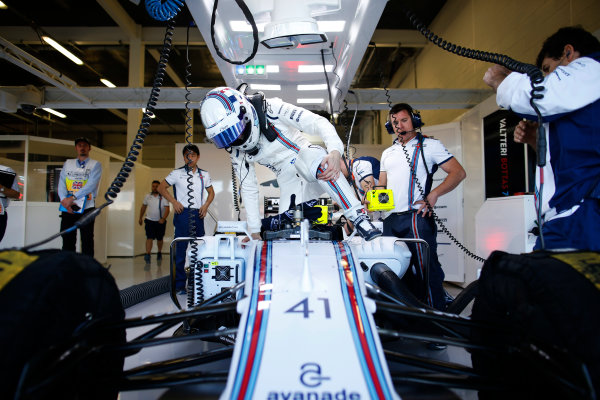 Silverstone, Northamptonshire, England. Friday 03 July 2015. Susie Wolff, Williams FW37 Mercedes climbs into her car. World Copyright: Glenn Dunbar/LAT Photographic. ref: Digital Image _89P0226