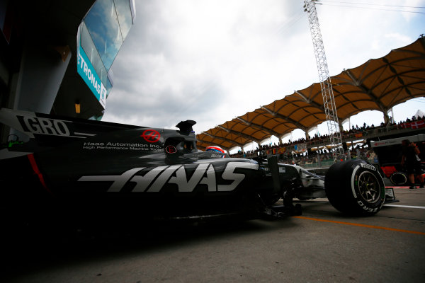 Sepang International Circuit, Sepang, Malaysia. Saturday 30 September 2017. Romain Grosjean, Haas VF-17, exits his pit garage. World Copyright: Andy Hone/LAT Images  ref: Digital Image _ONZ9268