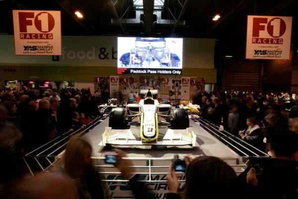 NEC, Birmingham. 16th January 2010.Visitors admire the Brawn GP BGP001 on the F1 Racing stand.World Copyright: Drew Gibson/LAT Photographicref: Digital Image _Y8P5458