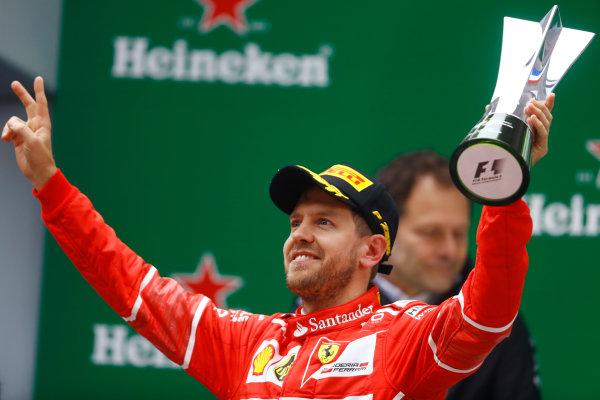Shanghai International Circuit, Shanghai, China.  Sunday 09 April 2017.  Sebastian Vettel, Ferrari, 2nd Position, celebrates with his trophy on the podium. World Copyright: Steven Tee/LAT Images  ref: Digital Image _O3I5496