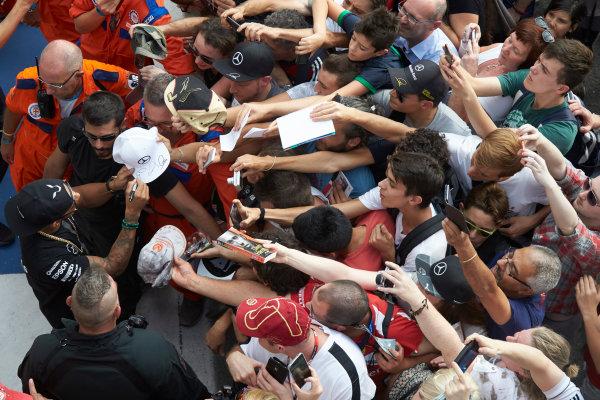 Autodromo Nazionale di Monza, Monza, Italy. Thursday 3 September 2015. Lewis Hamilton, Mercedes AMG, signs autographs for fans. World Copyright: Steve Etherington/LAT Photographic ref: Digital Image SNE23469