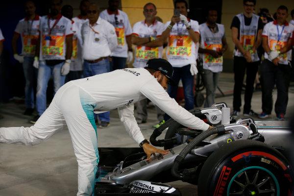 Bahrain International Circuit, Sakhir, Bahrain. Saturday 2 April 2016. Lewis Hamilton, Mercedes AMG celebrates after taking Pole Position. World Copyright: Glenn Dunbar/LAT Photographic ref: Digital Image _W2Q5725