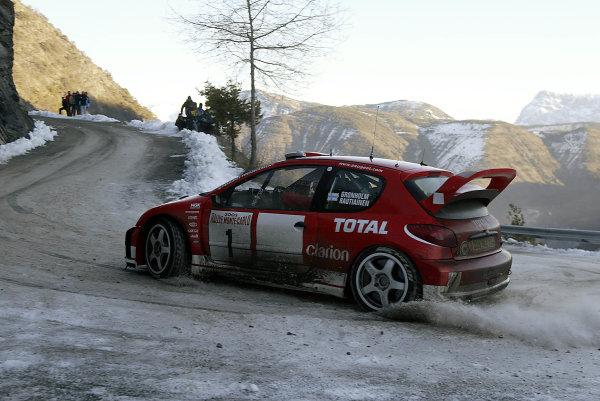 2003 FIA World Rally Championship. Monte Carlo, Monaco. Rd1.23-26 January 2003.Marcus Gronholm/Timo Rautiainen (Peugeot 206 WRC).World Copyright: McKlein/LAT Photographic