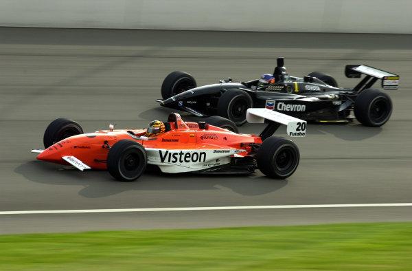 2002 Fontana CART, California Speedway, USA, 3 November, 2002Oriol Servia races with Cristiano da Matta-2002, Lesley Ann Miller, USALAT Photographic