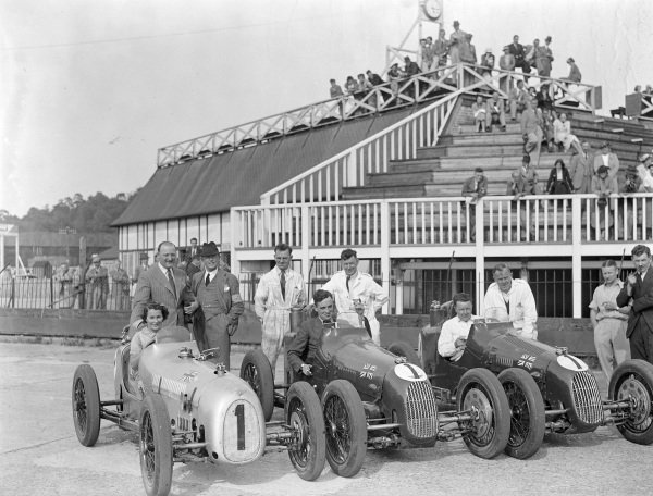 The winning Austin team sit in their cars after the race: Kay Petre, C. Goodacre, and Herbert Hadley.
