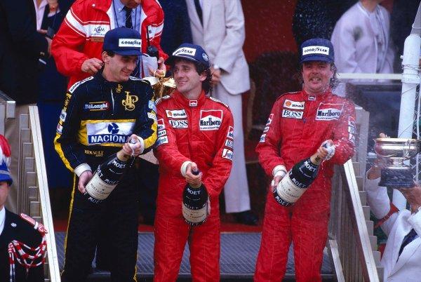 1986 Monaco Grand Prix.Monte Carlo, Monaco.8-11 May 1986.Alain Prost, 1st position, Keke Rosberg, 2nd position (both McLaren TAG Porsche) and Ayrton Senna (Team Lotus) 3rd position on the podium.Ref-86 MON 03.World Copyright - LAT Photographic