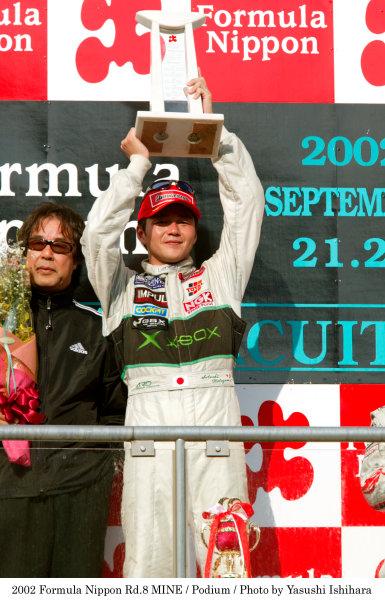 2002 Formula Nippon ChampionshipMine, Japan. 22nd September 2002.Race winner Satoshi Motoyama (XBOX Impul), podium.World Copyright: Yasushi Ishihara/LAT Photographicref: Digital Image Only