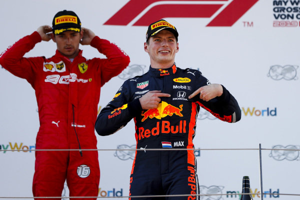 Race winner Max Verstappen, Red Bull Racing celebrates on the podium with Charles Leclerc, Ferrari