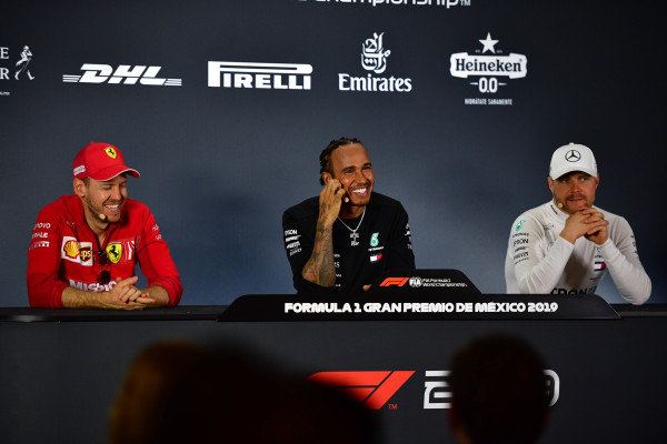 Sebastian Vettel, Ferrari, Race winner Lewis Hamilton, Mercedes AMG F1 and Valtteri Bottas, Mercedes AMG F1 in Parc Ferme