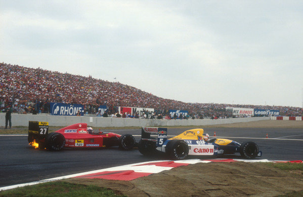 1991 French Grand Prix.Magny-Cours, France.5-7 July 1991.Nigel Mansell (Williams FW14 Renault) passes Alain Prost (Ferrari 643) at the Adelaide Hairpin. They finished in 1st and 2nd positions respectively.Ref-91 FRA 04.World Copyright - LAT Photographic